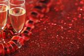 Champagne on glitters — Stock Photo