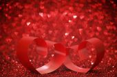 Red ribbon hearts on glitters — Foto Stock