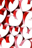 Linked ribbon hearts — Stock Photo