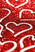 Glitter background with hearts — Stock Photo