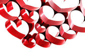 Red ribbon hearts — Stock Photo