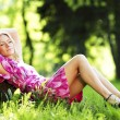 Woman sitting under tree — Stock Photo #70636023