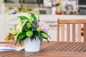 A small bouquet of flowers on the table — Stock Photo