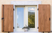 Window with open wooden shutters — Stock Photo