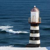 Lighthouse on coast of Pacific Ocean. Kamchatka Peninsula — Foto Stock