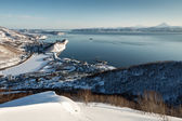 Panoramic view of Petropavlovsk-Kamchatsky City, Avacha Bay  and Pacific Ocean at sunset. Russia, Kamchatka Peninsula — Stock Photo