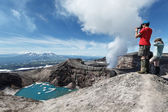 Tourists in crater of active Gorely Volcano takes a picture. Russia, Kamchatka — Stock Photo