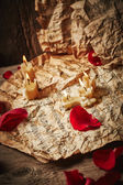 Music sheets with rose petals — Stockfoto