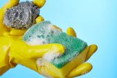 Woman's hands in gloves with sponge  — Stock Photo