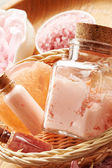 Spa still life with soap, sea salt and flower petals — Stock Photo
