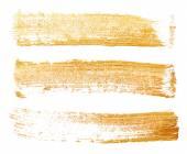 Strokes of golden paint — Stock Photo