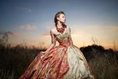 Beautiful girl in a long dress — Stock Photo