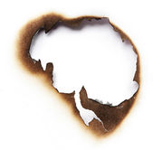 Burnt hole of paper — Stock Photo