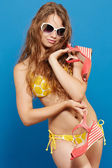 Young girl in yellow swimsuit — Stock Photo