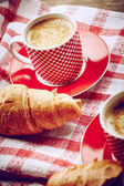Cup of coffee with croissant — Stock Photo