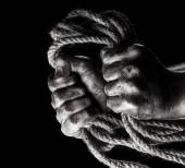 Male hand with rope. Conception aggression — ストック写真