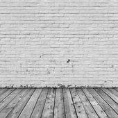 Tegel vägg och trä golv — Stockfoto
