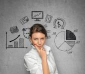 Thinking Woman with business sketches — Stock Photo