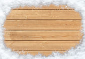 Snow-covered wooden surface — Stock Photo