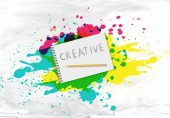 Writing pad with the word creative — Stock Photo