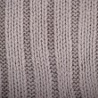 Detail of crocheted gray texture from a sweater made of wool — Stock Photo #62875643