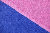 Pink and blue towel, boy and girl, texture, colorful background — Stock Photo