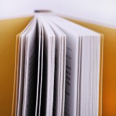 Open book upright on a white background — Stock Photo