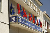 SHKODRA, ALBANIA - May 30, 2015. Flags on the building of a political party in a democratic Albania, Shkodra. — Stock Photo