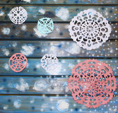 Picturesque paper snowflakes on a blue wooden table, a Christmas — Fotografia Stock