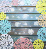 Carved colorful paper snowflakes on a blue wooden background, Ch — Stock Photo