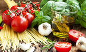 Italian Cooking Ingredients, Spaghetti,Tomates,Olive Oil and Bas — Stock Photo