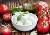 Italian Mozzarella with Tomatoes,Olive Oil and Basil — Stock Photo