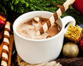 Hot Chocolate with Spiral Snack and Christmas Decoration — Stock Photo
