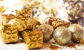 Shiny Golden Christmas Gifts and Balls — Stock Photo