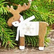 Vintage Wooden Reindeer Christmas Decoration and Fir Tree Branch — Stock Photo #58374159