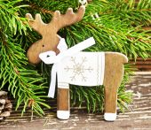 Vintage Wooden Reindeer Christmas Decoration and Fir Tree Branch — Stock Photo