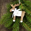 Vintage Wooden Reindeer Christmas Decoration and Fir Tree Branch — Stock Photo #58427855