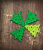 Decorative Christmas Trees on Wooden Background — Stock Photo