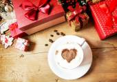 Heart Shape Cappuccino Cup with Whipped Cream and Wrapped Gifts — Stock Photo