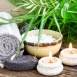 Spa Setting wiht Green Leaves and Burning Candles — Stock Photo #66596343
