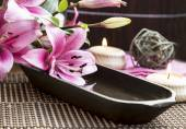 Spa Setting with Lilies and Water Wooden Bowl — Stock Photo