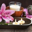 Spa Floating Burning Candles and Lilies — Stock Photo #67792493