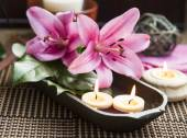 Spa Floating Burning Candles and Lilies — Stock Photo