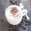 Cappuccino Cup with Creamy Froth and Cocoa Powder — Stock Photo #70818371