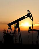 Oil pump jack silhouette — Stock Photo