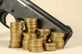 Gun and money — Stock Photo