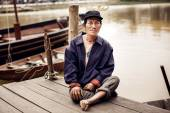 Old man on a pier on river,Vietnam. — Stockfoto
