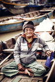 Old man on a boat in river,Vietnam. — Stockfoto