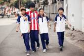 Unidentied boys walking on street  in Ho Chi Minh — Stock Photo