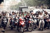 The streets of Saigon are crowded with scooters, motorbikes and bicycles — Stock Photo
